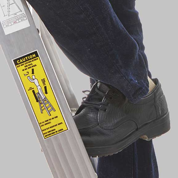 Closeup of man on ladder that has a safety label on the side