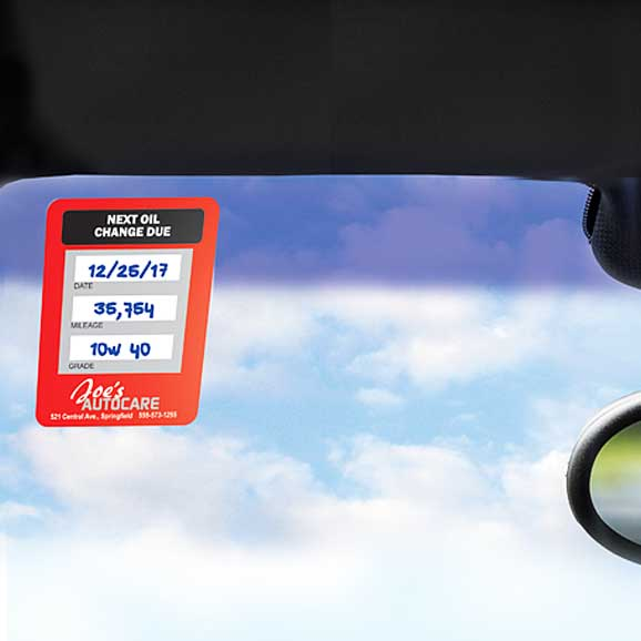 Oil change static cling label in car window