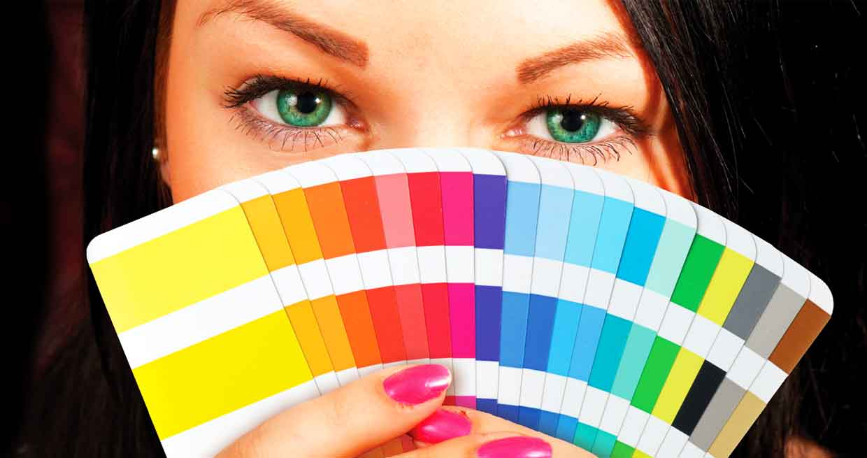 Slider image of woman holding color swatches